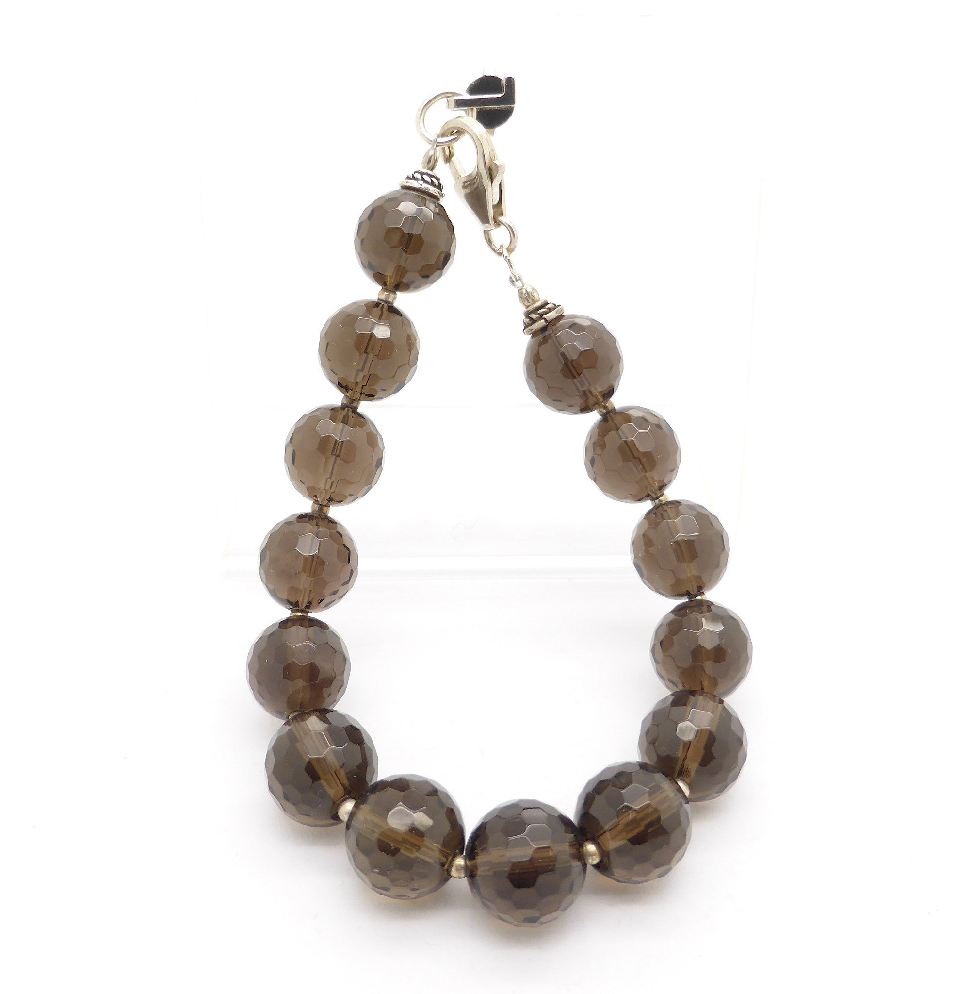 Faceted Smoky Quartz Beads Bracelet | 925 Sterling Silver and Tiger Tail | Nice mellow colour | Fair Trade and well made | Smoky is down to Earth in a conscious way empowering you to deal with physical issues internal or external | Genuine Gems from Crystal Heart Australia since 1986