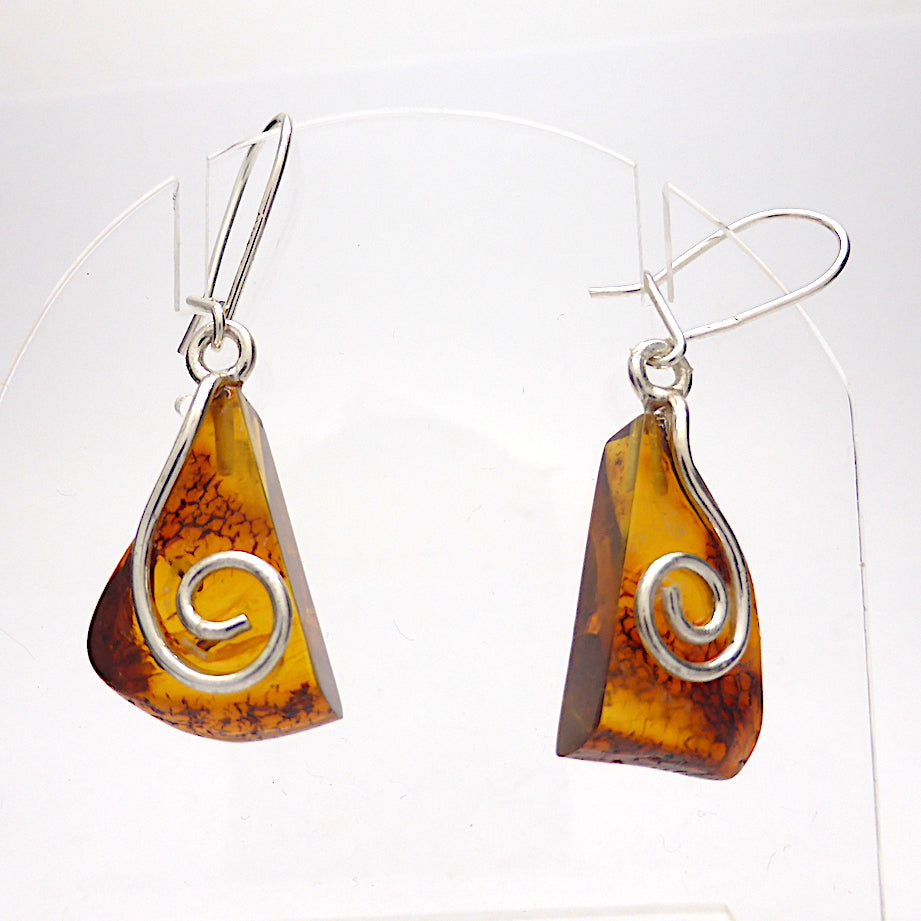 Baltic Amber Earrings | 925 sterling Silver | Delightful earrings sliced from same nugget | safety hooks | Unfortunately some clear glue on surface so price reduced | Crystal Heart Melbourne Australia since 1986
