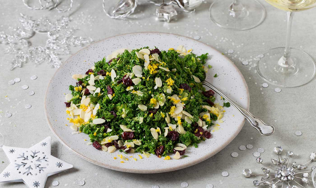 Crispy kale, cranberry and toasted almond salad with a clementine and ginger dressing