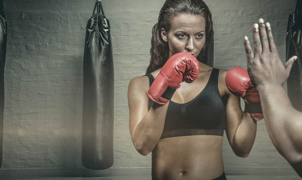 bare-biology-fitness-get-strong-and-sexy-with-our-3-favourite-boxing-studios-woman-boxing