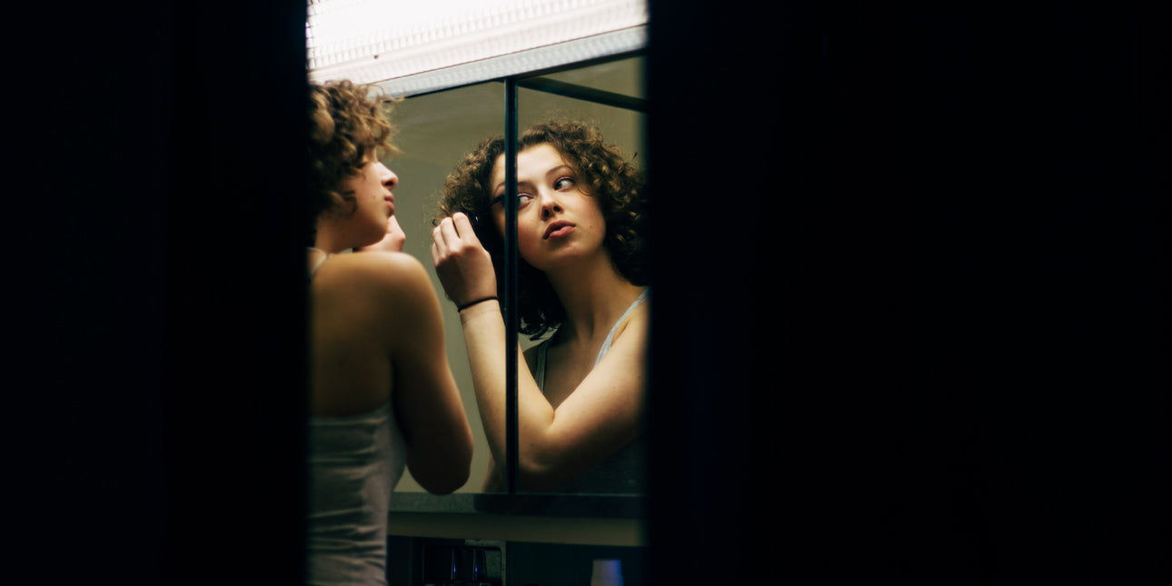 bare-biology-omega-3-a-woman-doing-her-makeup-in-a-mirror