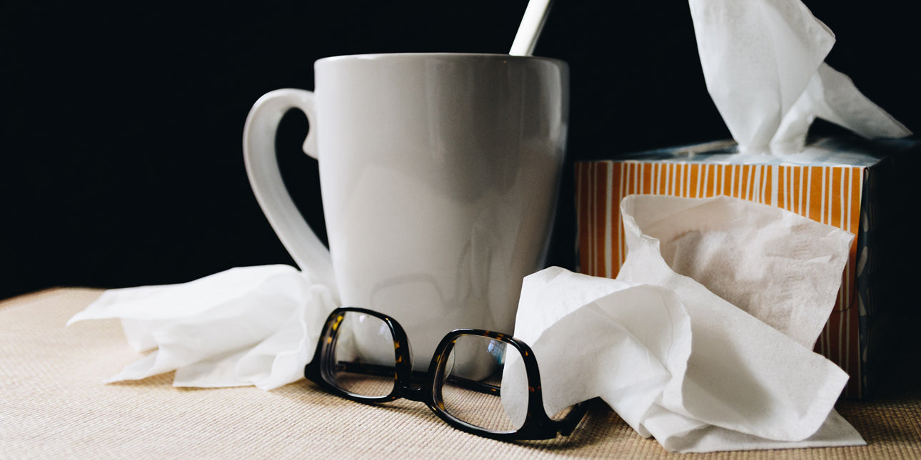 bare-biology-omega-3-a-pile-of-used-tissues-with-glasses-and-a-mug-of-tea
