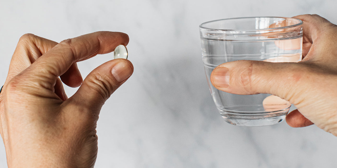 lion-heart-capsule-and-glass-of-water