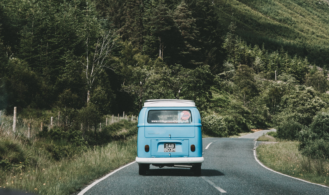 a-blue-camper-van-on-the-road