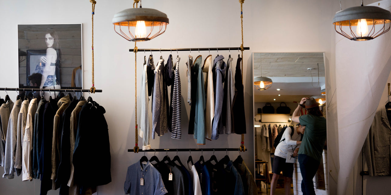 a-menswear-shop-with-rails-of-shirts