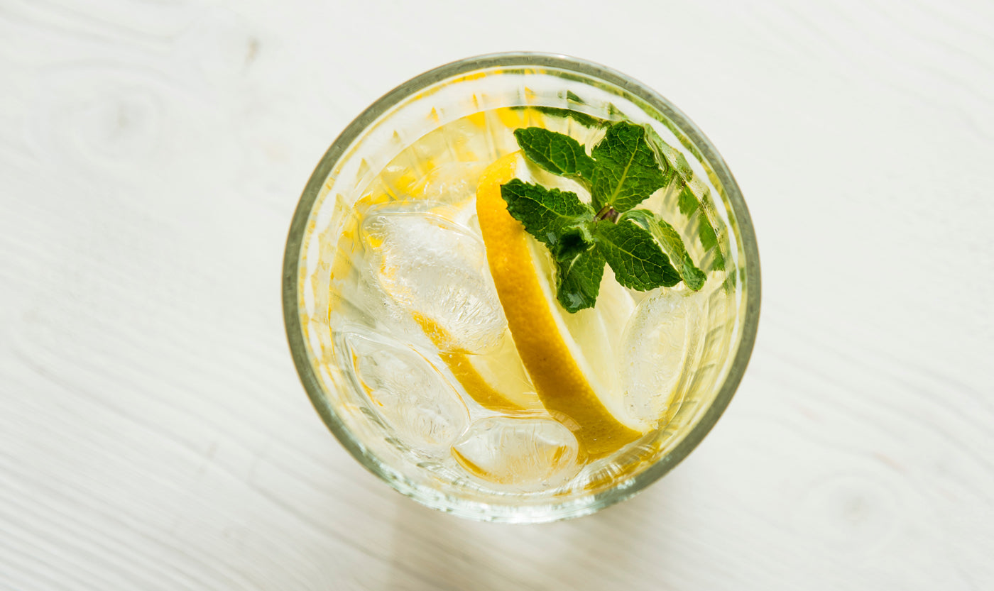 bare-biology-omega-3-a-glass-of-water-with-lemon