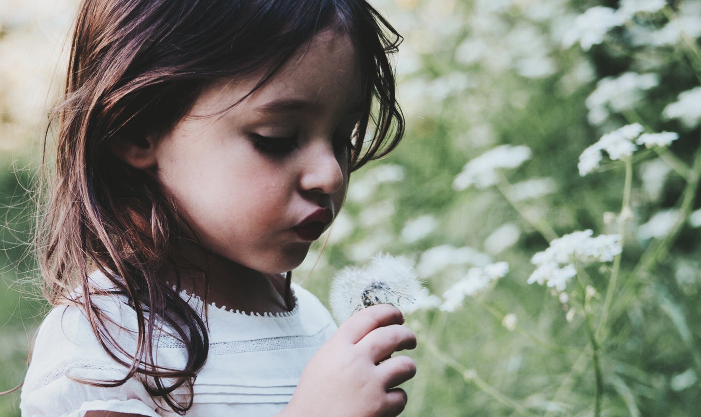 bare-biology-omega-3-a-little-girl-with-a-flower-in-a-garden