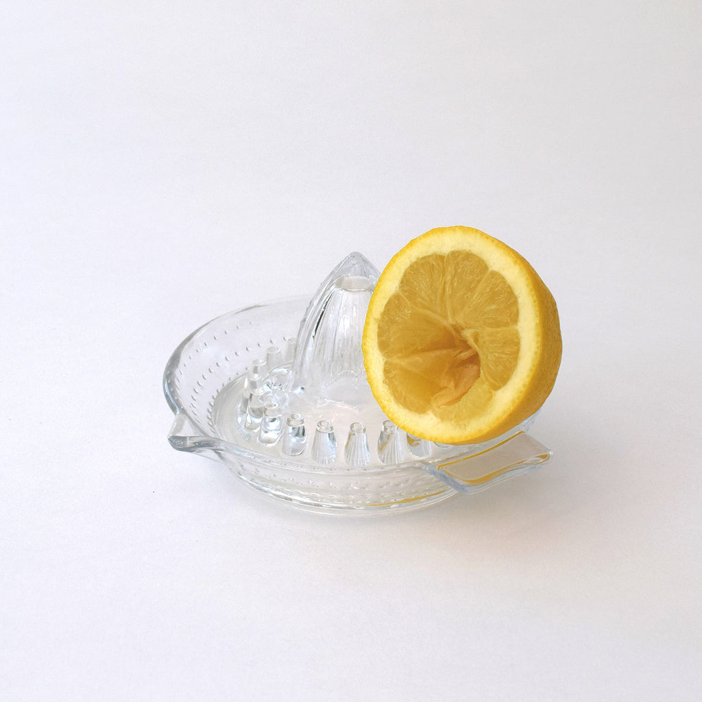 Traditional glass lemon squeezer