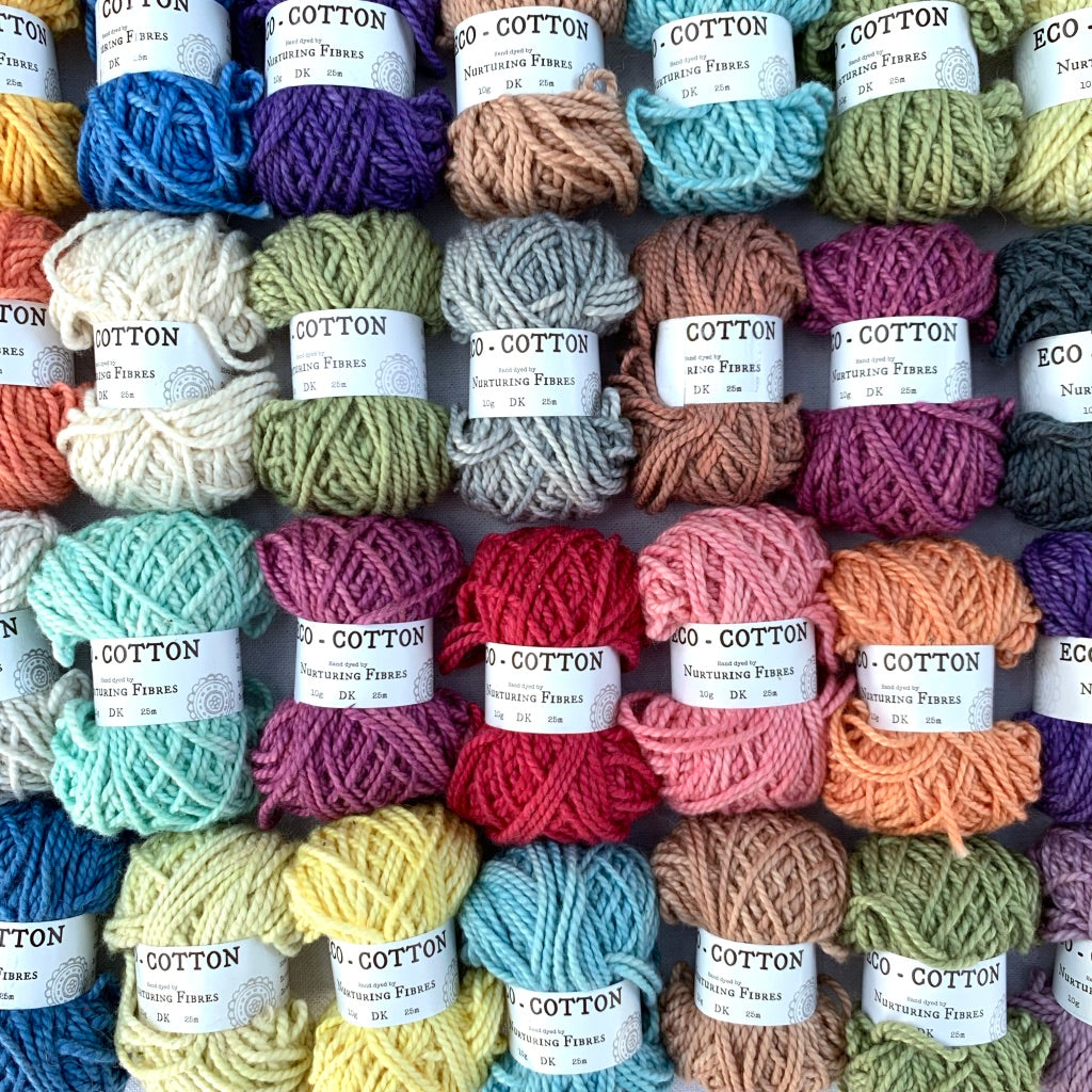 Eco-Bonbons in Nurturing Fibres Eco-Cotton, assorted colors, arranged in a grid