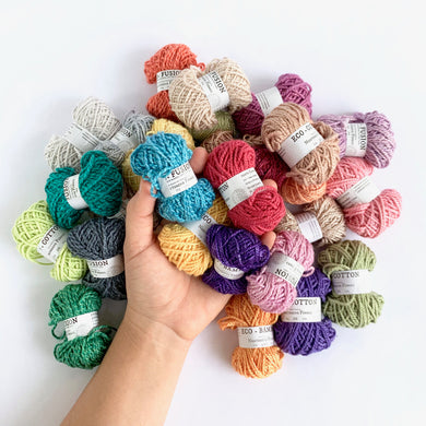 Eco-Bonbons by Nurturing Fibres many colors, with hand for scale