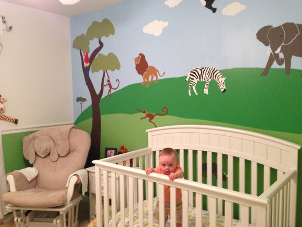 Jungle wall stencils help mom and dad create nursery wall for Creating a mural