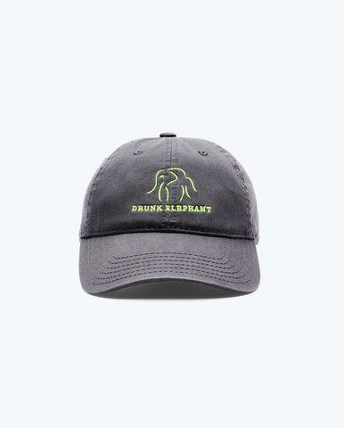 head on view of a charcoal Drunk Elephant baseball cap and bright green Drunk Elephant logo against a white background