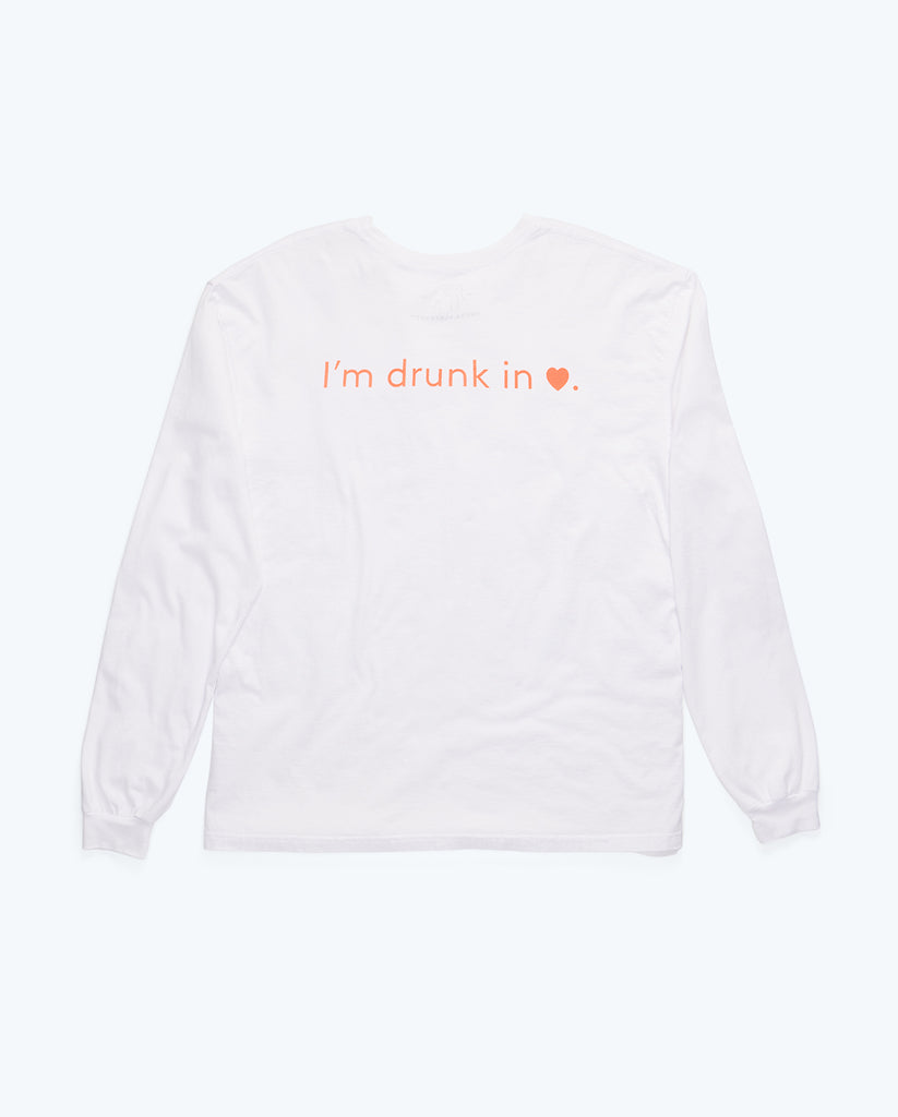 "back of white cotton long-sleeved crewneck shirt with the phrase ""I'm drunk in love"" in orange letters where the word love is represented by a heart symbol"