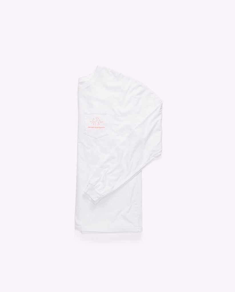 white crewneck cotton long-sleeved shirt folded in half lengthwise with the drunk elephant logo showing and one sleeve folded across the front