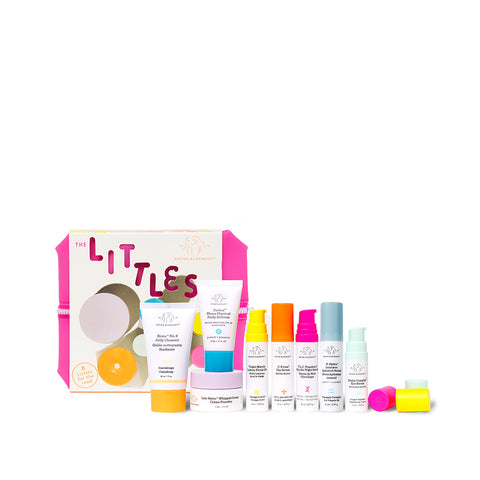The Littles Drunk Elephant Starter Kit featuring Beste Cleanser, Umbra Sunscreen, Lala Moisturizer, Vitamin C Serum, Night Serum, Eye Serum and More in a cute, pink travel bag