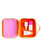 neon orange dopp kit zipped open with Marula Oil, TLC Framboos Glycolic Night Serum and Beste number 9 displayed inside