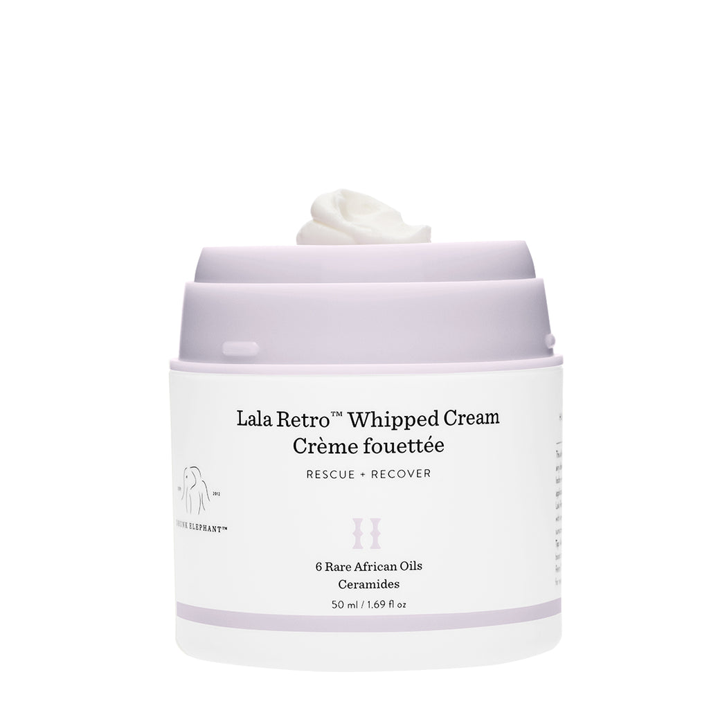 A front view of Lala Retro Whipped Cream moisturizer with Ceramides without the cap and showing product on the jar top.