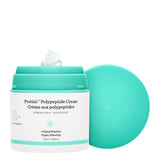 Protini pump with the cap propped up to the side and a dollop of moisturizer swirled on top against a white background