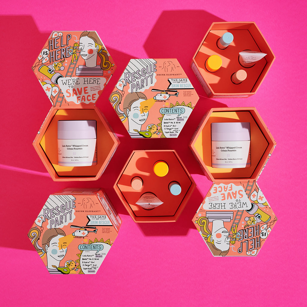 Two Octagon-Shaped Rescue Party Kits with compartments opened to reveal Lala Retro and the Minis