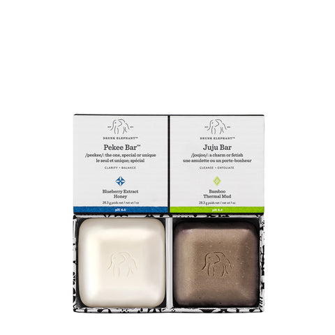 travel-sized Pekee and Juju facial cleansing bars in open cardboard outer packaging