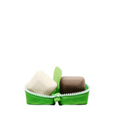 Travel-sized Pekee and Juju facial cleanser bars shown in open zippered travel case