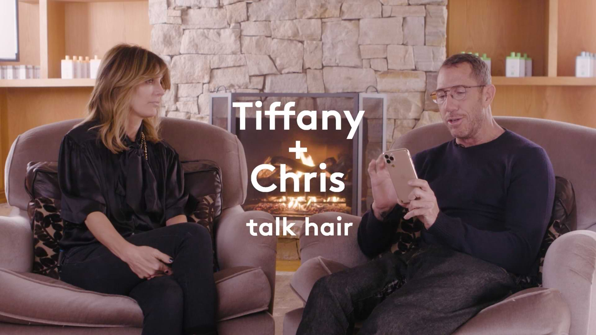 video of Drunk Elephant founder Tiffany Masterson and celebrity hair stylist Chris McMillan chatting in front of a cozy fireplace