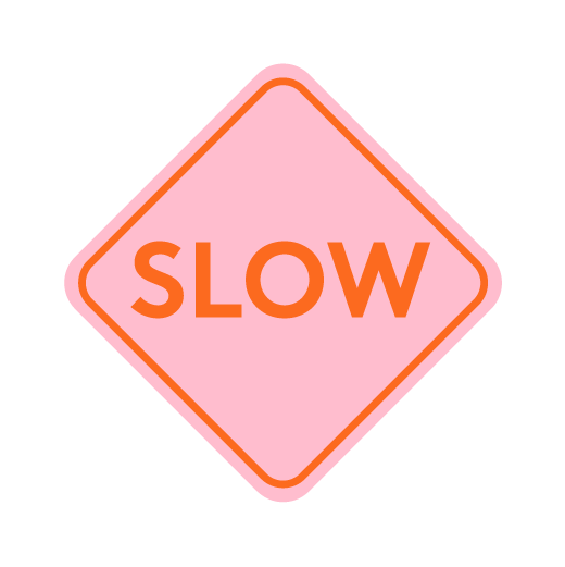 "Pink diamond-shaped sign with orange ""slow"" text"