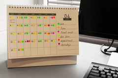 small colored dot stickers on calander