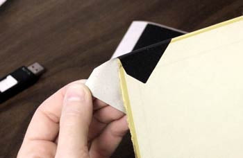 Applying Cloth Repair Corner to Book