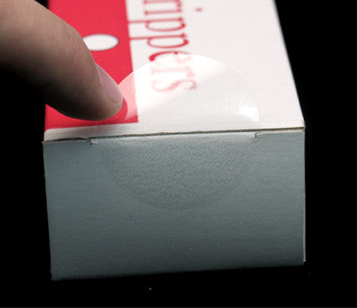 "1.5"" Clear Dot Label Sticking on a Box"