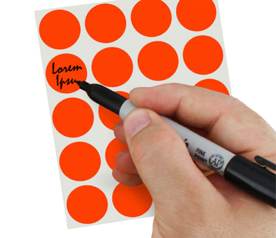 A Person's hand writing Lorem Ipsum on a sticker with a felt tip marker