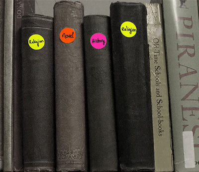 Stickers that color code books based on genre