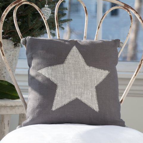 Pillow, hand appliquéd star with felted pom poms