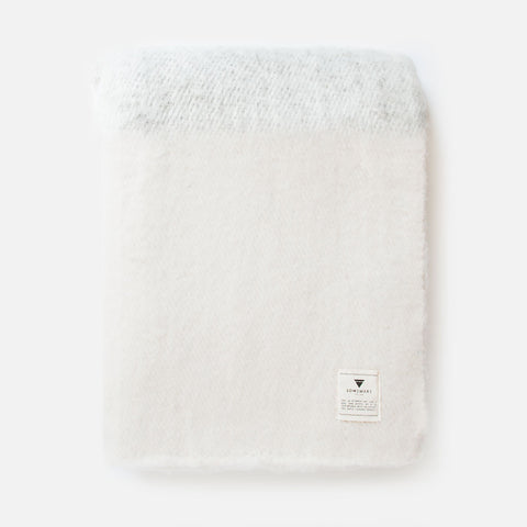 Handmade white and thick virgin wool throw (top folded view)