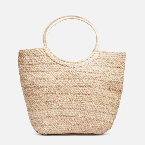 Straw medium sized handwoven basket bag with circle handles (front view)