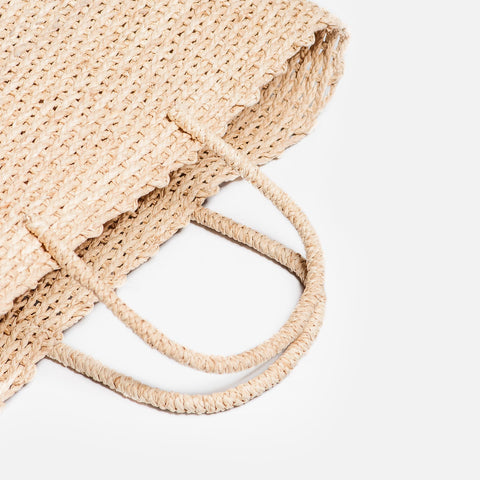 Someware brigette basket bag lying down