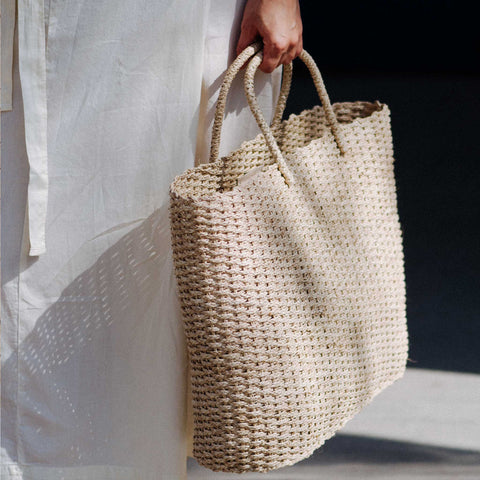 Woman holding Brigette Basket Bag