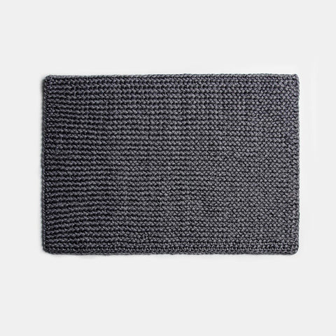 Solid and Sustainable handwoven crochet doormat in dark grey (top view)