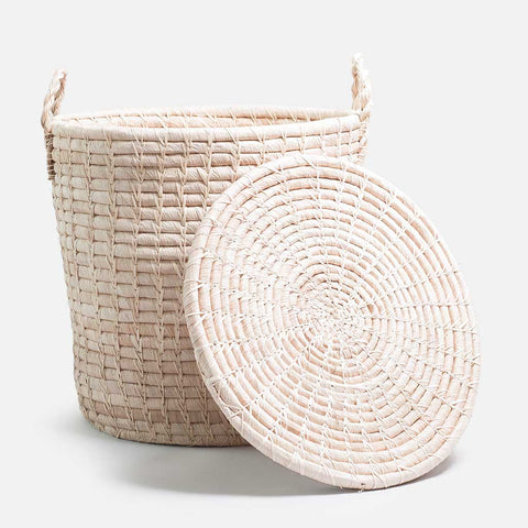Solid and sustainable handwoven straw hamper with handles and lid off (front view)