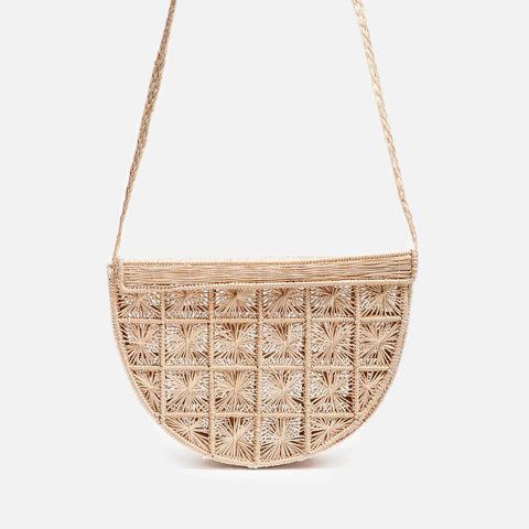 Solid and sustainable handmade straw crossbody bag, half-moon shape with basketry  (front view)