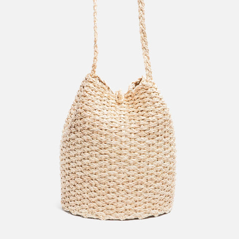 Solid and sustainable handmade straw bucket bag  with visible stitches (front view)