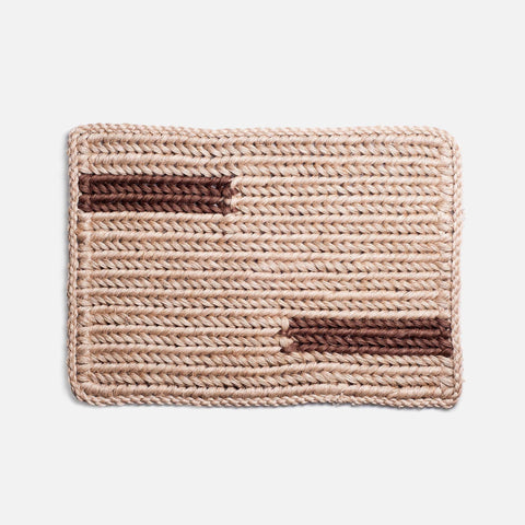 Solid and Sustainable handwoven straw doormat with chestnut brown bars (top view)