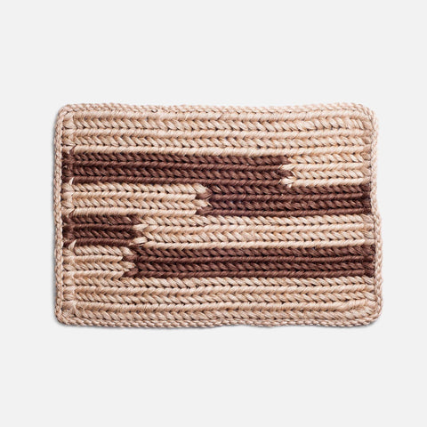 Solid and Sustainable handwoven straw doormat with chestnut brown stripes (top view)