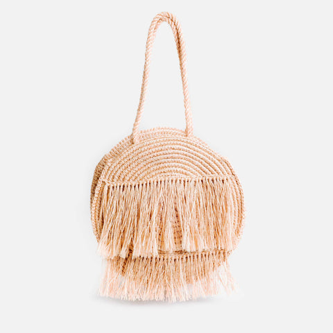 Solid and Sustainable handwoven guava pink circle bag with fringes (front view)