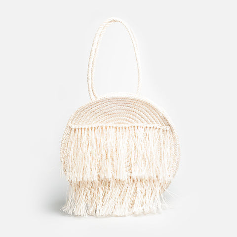 Solid and Sustainable handwoven straw circle bag with fringes (front view)