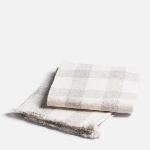 Handmade thin wool throw with grey plaid pattern (folded view)