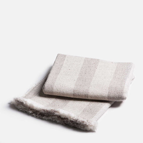 Handmade thin wool throw with grey stripes (folded view)
