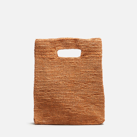 Solid and sustainable handwoven handbag in ginger brown (front view)