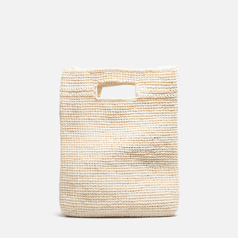 Solid and sustainable handwoven cream white handbag (front view)