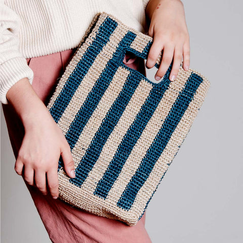 Solid and sustainable handwoven blue stripes handbag (lifestyle view)